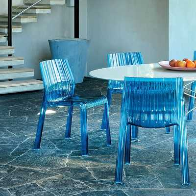 frilly-kartell-chairs-matching-with-glossy-table.jpg